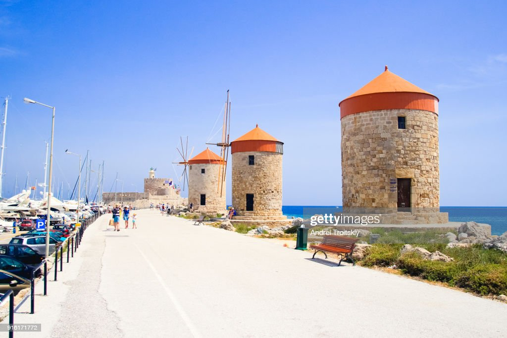 Mandraki harbour with windmills, Rhodes, Greece : Stock Photo