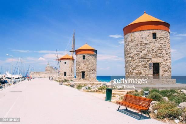 Mandraki harbour with windmills, Rhodes, Greece