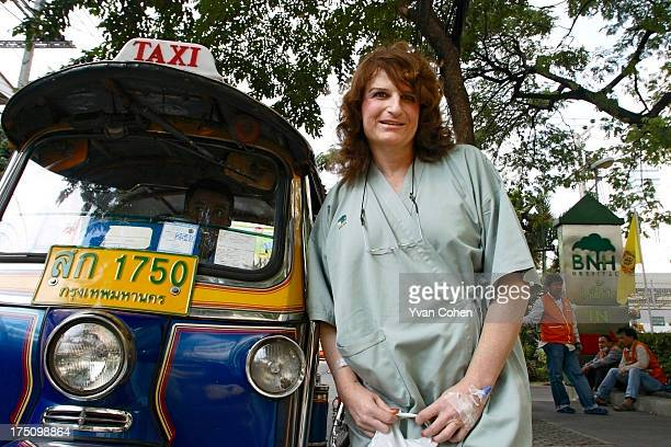Mandy a 49yearold American transexual stands beside a TukTuk outside the Bangkok Nursing Home hospital in downtown Bangkok After years of...