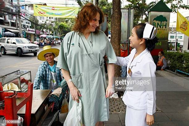 Mandy a 49yearold American transexual talks with her nurse outside the Bangkok Nursing Home hospital in downtown Bangkok After years of ostracisation...