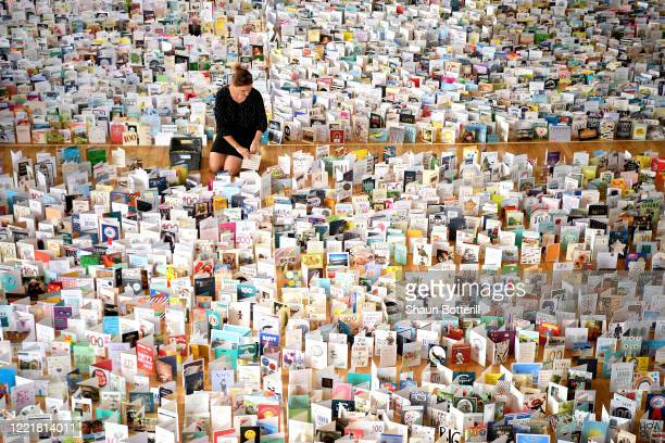 Mandy Alison adds to the thousands of birthday cards sent to Captain Tom Moore for his 100th birthday on April 30th, are pictured displayed in the...