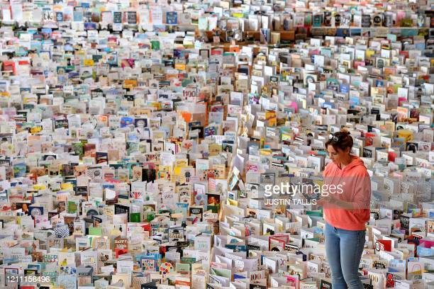 Mandy Alison poses with a selection of over 125,000 birthday cards sent to Captain Tom Moore, for his 100th birthday on April 30th, but displayed in...