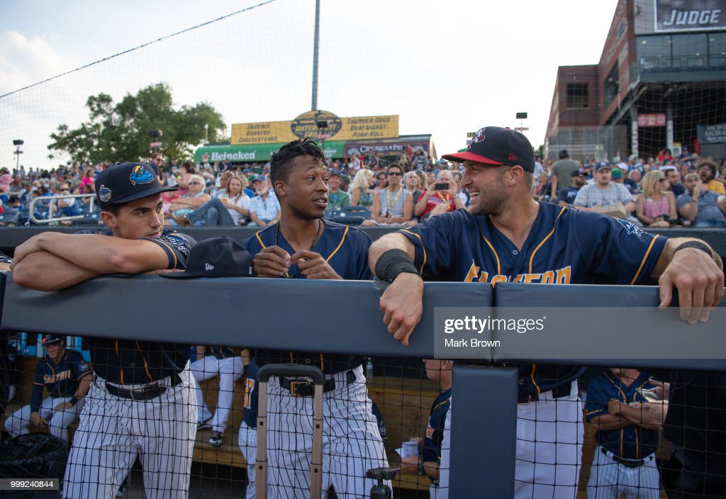 Mandy Alvarez #3, Jan Hernandez #7 and Tim Tebow #15 of the Eastern Division All-Stars in the dugout during the 2018 Eastern League All Star Game at Arm & Hammer Park on July 11, 2018 in Trenton, New Jersey.