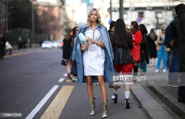 Mandy Bork is seen wearing a white dress and a Bottega Veneta baby blue bag before Sportmax during Milan Fashion Week Fall/Winter 2020-2021 on...