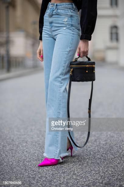 Mandy Bork is seen wearing black Zara jeans and cropped jacket, Balenciaga heels, Linda Farrow sunglasses, Dior bag on March 16, 2021 in Berlin,...