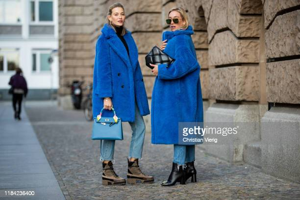 Mandy Bork is seen wearing blue teddy coat Max Mara, cropped denim jeans, Hermes bag, Louis Vuitton trekking boots and Sonia Lyson is seen wearing...