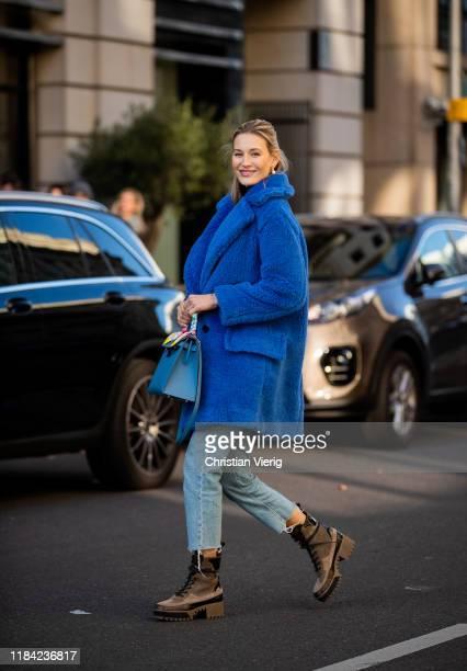 Mandy Bork is seen wearing blue teddy coat Max Mara cropped denim jeans Hermes bag Louis Vuitton trekking boots on October 29 2019 in Berlin Germany