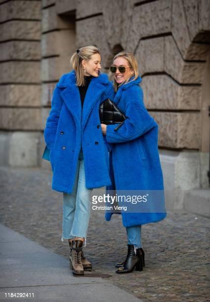 Mandy Bork is seen wearing blue teddy coat Max Mara, cropped denim jeans, Louis Vuitton trekking boots and Sonia Lyson is seen wearing blue teddy...