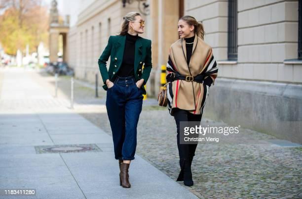 Mandy Bork is seen wearing brown Louis Vuitton ankle boots Fendi sunglasses dark denim jeans Zara black Zara turtleneck green double breasted Balmain...