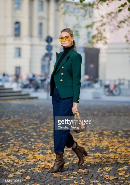 Mandy Bork is seen wearing brown Louis Vuitton ankle boots round Louis Vuitton bag Fendi sunglasses dark denim jeans Zara black Zara turtleneck green...