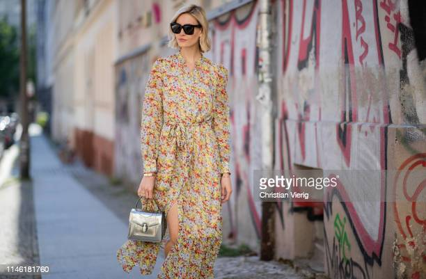 Mandy Bork is seen wearing dress with floral print other stories Bulgari bag Dior earrings Cartier jewellery Celine sunglasses on April 30 2019 in...