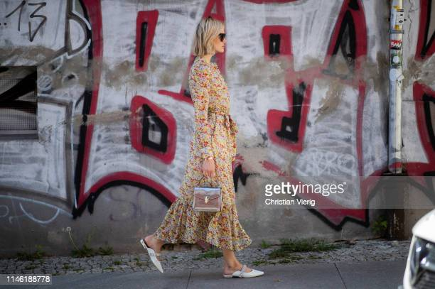 Mandy Bork is seen wearing dress with floral print other stories Kurt Geiger shoes Bulgari bag Cartier jewellery Celine sunglasses on April 30 2019...