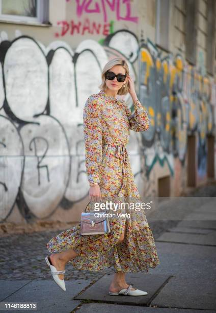 Mandy Bork is seen wearing dress with floral print other stories Kurt Geiger shoes Bulgari bag Dior earrings Cartier jewellery Celine sunglasses on...