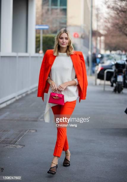 Mandy Bork is seen wearing orange suit outside Boss during Milan Fashion Week Fall/Winter 20202021 on February 23 2020 in Milan Italy