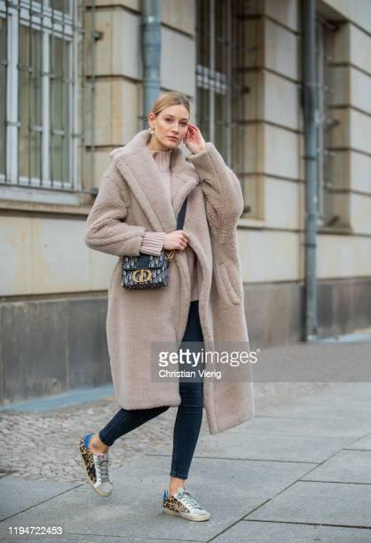 Mandy Bork is seen wearing pants Zara, turtleneck All Saints, Dior bag, Dior earrings, Max Mara teddy coat, Golden Goose sneakers on December 18,...