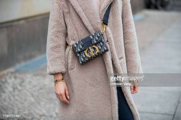 Mandy Bork is seen wearing pants Zara, turtleneck All Saints, Dior bag, Max Mara teddy coat on December 18, 2019 in Berlin, Germany.