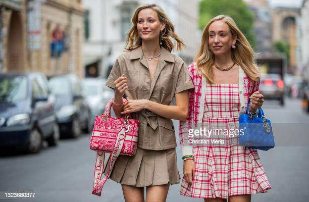 Mandy Bork is seen wearing red Dior bag, laced Dior boots, brown belted top and high waist skirt Dior and Sonia Lyson is seen wearing Dior bag blue,...
