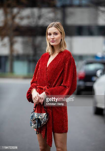 Mandy Bork is seen wearing red dress Retrofete, Dior bag with jungle print, Dior earrings on December 18, 2019 in Berlin, Germany.