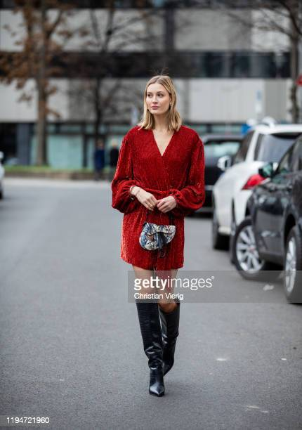 Mandy Bork is seen wearing red dress Retrofete, navy Jimmy Choo boots, Dior bag with jungle print, Dior earrings on December 18, 2019 in Berlin,...