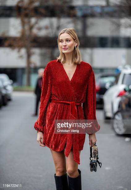 Mandy Bork is seen wearing red dress Retrofete navy Jimmy Choo boots Dior bag with jungle print Dior earrings on December 18 2019 in Berlin Germany
