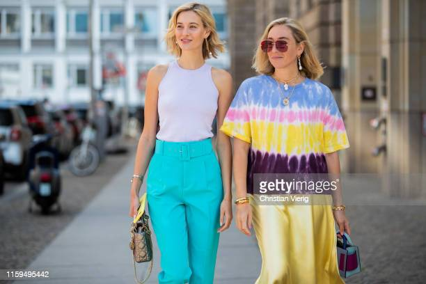 Mandy Bork is seen wearing turquois pants and white top Zara, Dior bag, Cartier and Dior jewellery, Kurt Geiger shoes and Sonia Lyson is seen wearing...