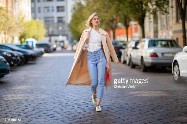 Mandy Bork is seen wearing white blouse Zara cropped denim jeans Zara red Hermes mini bag beige other stories trench coat shoes Golden Goose...