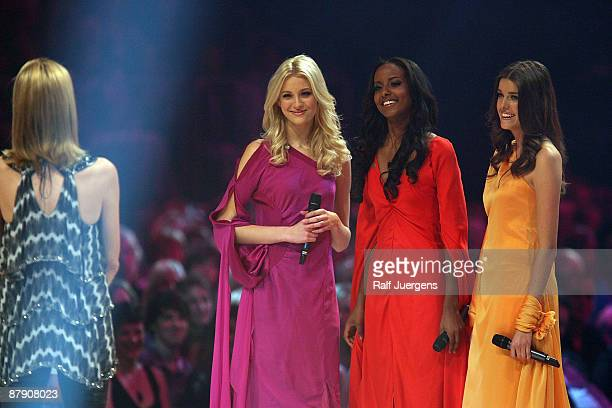 Mandy Bork Sara Nuru and Marie Nasemann perform during the PRO7 TV show Germany's Next Topmodel Final at the Lanxess Arena on May 21 2009 in Cologne...
