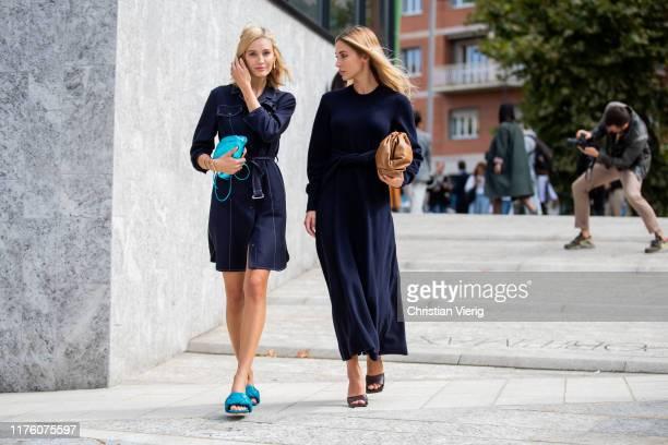 Mandy Bork seen wearing metallic blue mini pouch Bottega Veneta, shoes LIDO -PS20, navy dress and Ann-Kathrin Götze wearing brown pouch, navy dress...