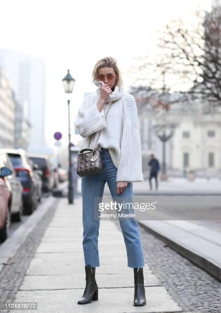 Mandy Bork wearing a white turtleneck sweater, Dior bag and Cartier jewelry on January 23, 2019 in Berlin, Germany.