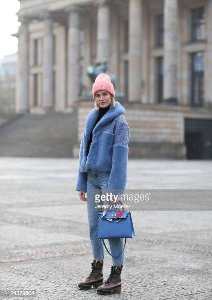 Mandy Bork wearing an Acne Studios beanie Hermes bag Cartier jewelry Samsoe Samsoe jacket and Louis Vuitton boots on January 23 2019 in Berlin Germany