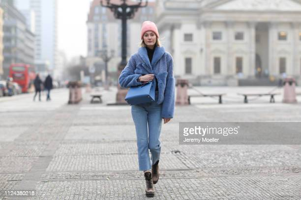 Mandy Bork wearing an Acne Studios beanie, Hermes bag, Cartier jewelry, Samsoe Samsoe jacket and Louis Vuitton boots on January 23, 2019 in Berlin,...