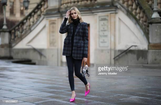 Mandy Bork wearing Balenciaga blazer and heels, Zara jeans, All Saints turtleneck and Dior saddle bag during the Berlin Fashion Week Autumn/Winter...