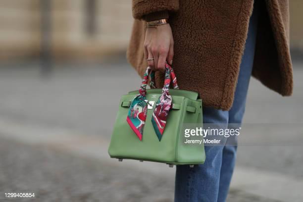 Mandy Bork wearing beige Max Mara coat, Hermes bag and Zara pants on January 29, 2021 in Berlin, Germany.