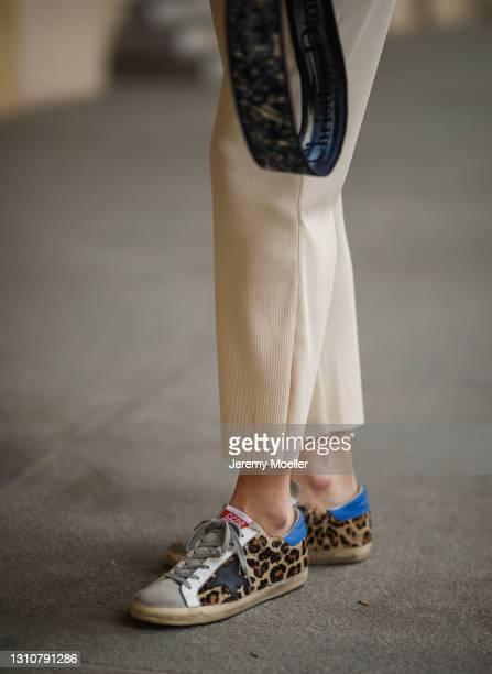 Mandy Bork wearing beige Zara pants and Golden Goose sneakers on April 01, 2021 in Berlin, Germany.