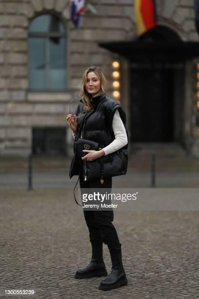 Mandy Bork wearing Bottega Veneta black boots, Zara black vest, Violante Nessie beige sweater, black Mango Jeans and Dior Bobby black leather bag on...