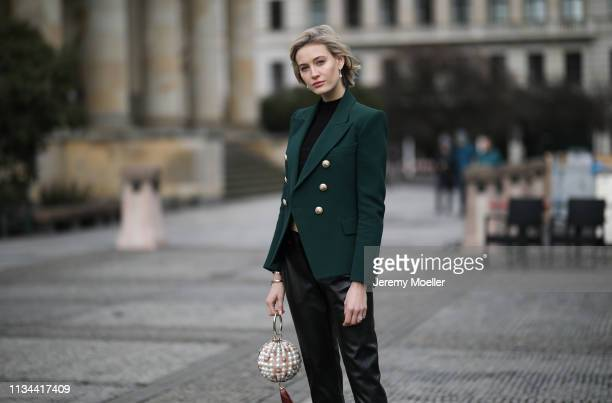 Mandy Bork wearing Christian Dior shoes Lyvem pants Balmain blazer Rosantica bag and Zara top on March 07 2019 in Berlin Germany
