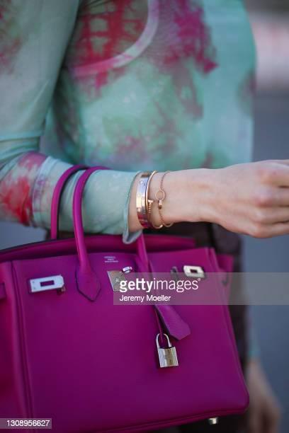 Mandy Bork wearing green Zara top and pink Hermès Birkin bag on March 22, 2021 in Berlin, Germany.