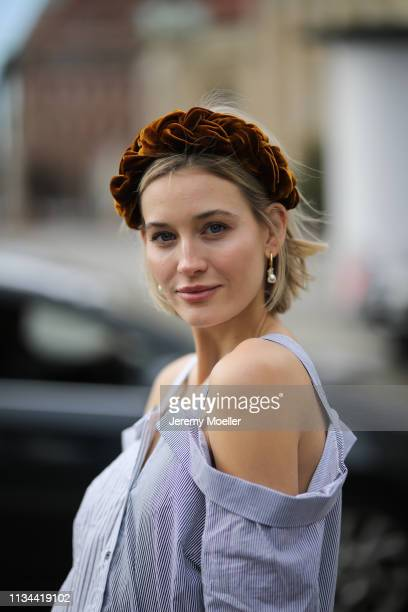 Mandy Bork wearing Jennifer Behr hairband and Storets blouse on March 07, 2019 in Berlin, Germany.