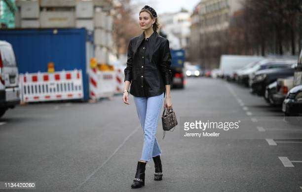 Mandy Bork wearing Jennifer Behr hairband Christian Dior bag Selected leather blouse Givenchy boots on March 07 2019 in Berlin Germany