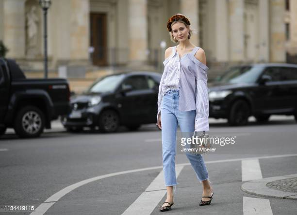 Mandy Bork wearing Jennifer Behr hairband Nakd jeans Dior shoes Storets blouse and Bulgari bag on March 07 2019 in Berlin Germany