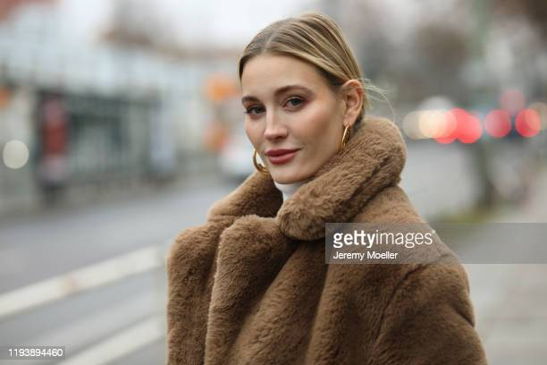 Mandy Bork wearing Jimmy Choo shoes, JBrand pants, Zara turtleneck, Dior bag, Cartier jewelry, Mango coat on December 12, 2019 in Berlin, Germany.