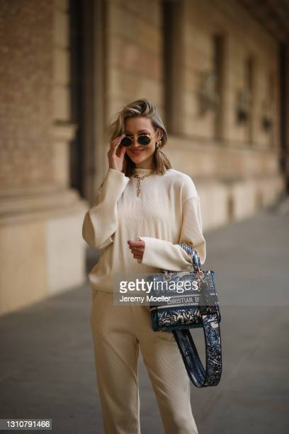 Mandy Bork wearing Linda Farrow shades, beige Zara two piece and blue Lady Dior bag on April 01, 2021 in Berlin, Germany.