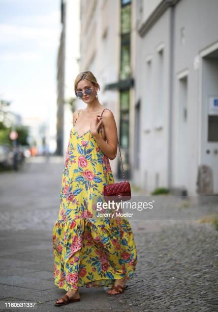 Mandy Bork wearing Miu Miu sunglasses via Sunglass Hut, Hermes shoes and Chanel bag on July 01, 2019 in Berlin, Germany.