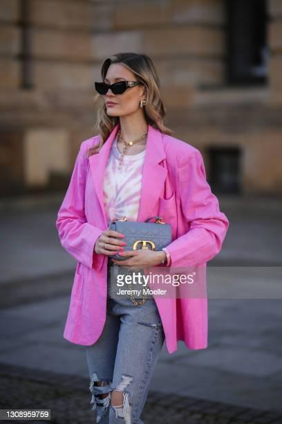 Mandy Bork wearing Philantrophy tie dye sweater, Zara destroyed jeans, pink Storets blazer, black Sunglass Hut x Chiara Ferragni shades and blue Dior...