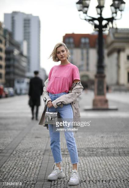 Mandy Bork wearing Saint Laurent shirt Burberry trench coat Bulgari bag Balenciaga Triple S Nakd jeans Cartier jewelry and Dior earrings on March 07...
