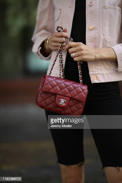 Mandy Bork wearing Zara shorts, Isabel Marant jacket, Chanel bag, Dior earrings, Messika chain, Cartier bracelet and aquazurra shoes on July 02, 2019...