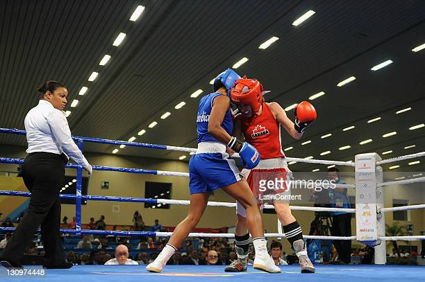 Mandy Bujold of Canada and Ingrid Valencia of Colombia in action during the final of the 4851kg fly category of boxing competition as part of the XVI...
