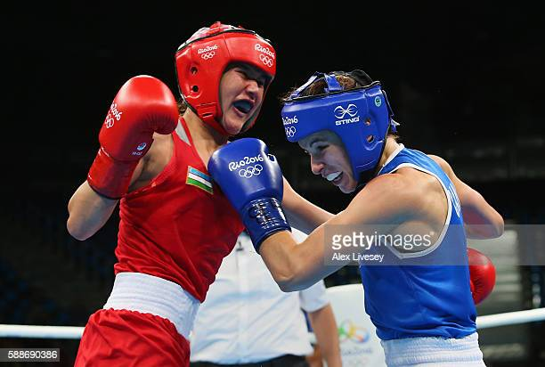 Mandy Bujold of Canada and Yodgoroy Mirzaeva of Kazakhstan trade punches during the Women's Flyweight Preliminaries bout on Day 7 of the 2016 Rio...