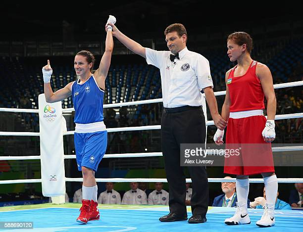 Mandy Bujold of Canada celebrates victory over Yodgoroy Mirzaeva of Kazakhstan in the Women's Flyweight Preliminaries on Day 6 of the 2016 Rio...