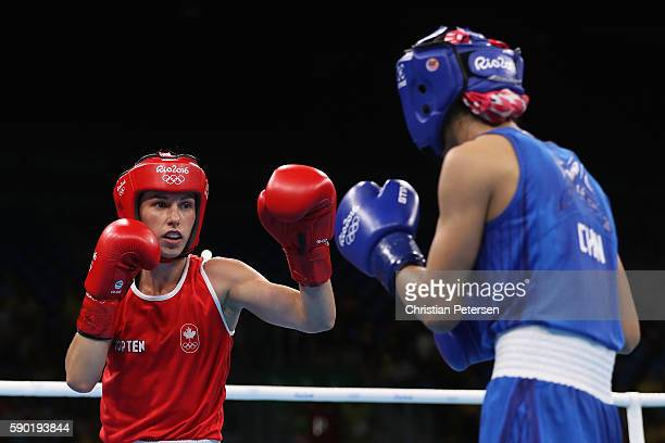 Mandy Bujold of Canada firghts Cancan Ren of China in the boxing Women's Fly Quarterfinal 2 on Day 11 of the Rio 2016 Olympic Games at Riocentro on...